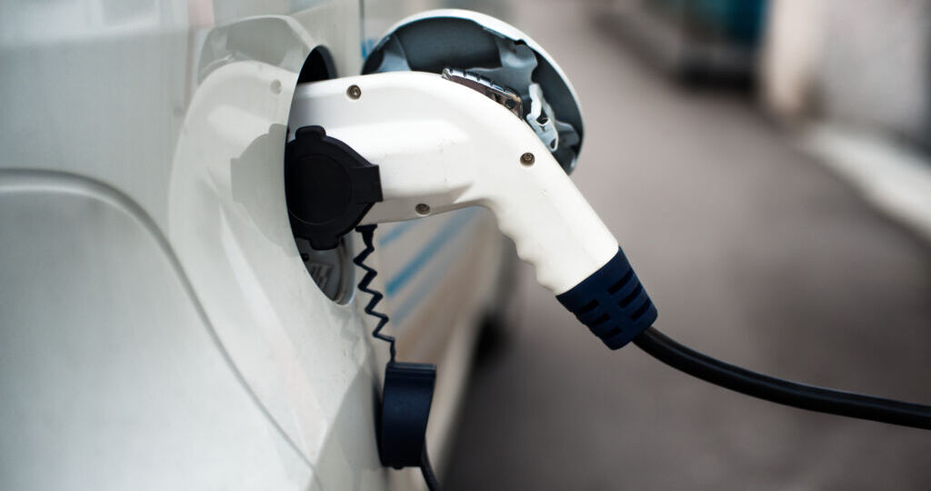 Charging,An,Electric,Car,With,The,Power,Cable,Supply,Plugged