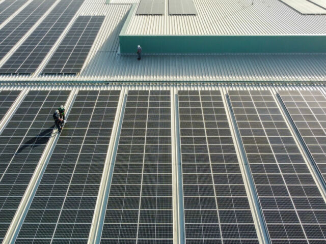 Solar,Panels,Installed,On,A,Roof,Of,A,Large,Industrial